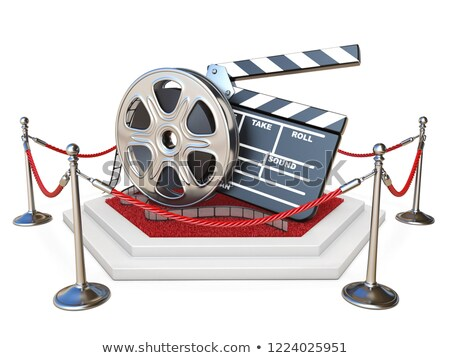 Film reel and clapper board on podium with red carpet 3D Stock photo © djmilic