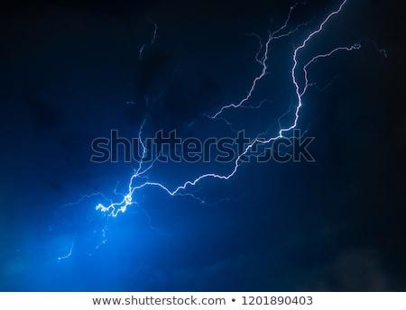 lightning flash on black background stock photo © kayros
