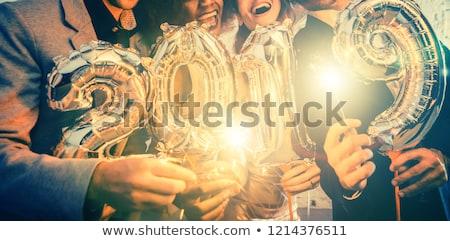 Groep partij mensen vieren aankomst mannen Stockfoto © Kzenon