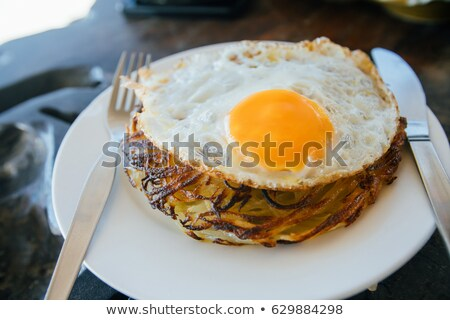 Potato pancakes with eggs and ham stock photo © Peteer