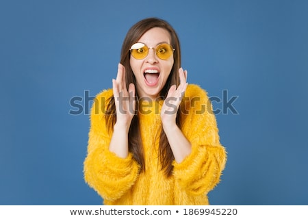 Image of brunette woman 20s wearing casual clothing speaking on  Stock photo © deandrobot