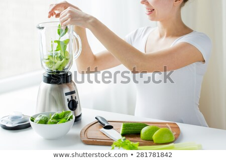 close up of woman with blender and vegetables Stock photo © dolgachov