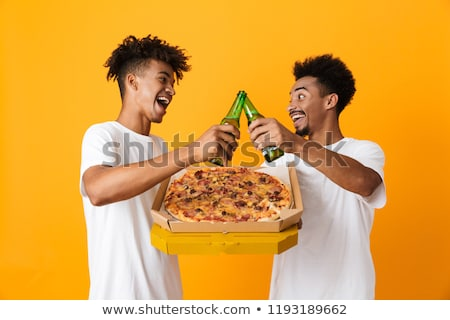 Two delighted african man friends Stock photo © deandrobot