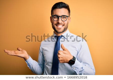 happy young businessman wearing shirt stock photo © deandrobot
