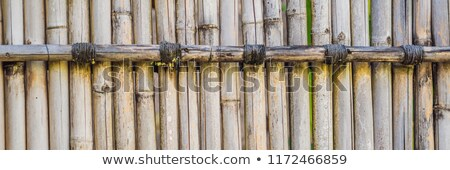 old brown tone bamboo plank fence texture for background banner long format stock photo © galitskaya