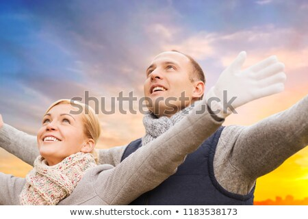 happy couple in autumn clothes over sunset in city Stock photo © dolgachov