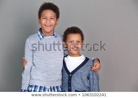 Dois bonitinho irmãos casual roupa crianças Foto stock © Lopolo