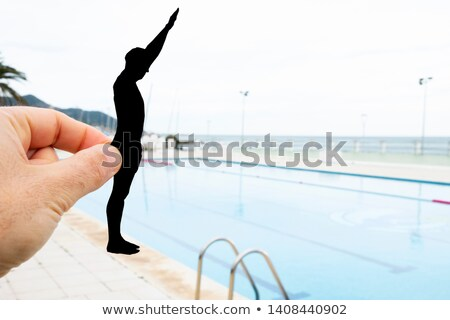 silhouette of a man throwing himself into a pool Stock photo © nito