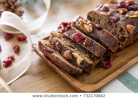 Christmas Cake decorated with berries on the wooden table Stock photo © dashapetrenko