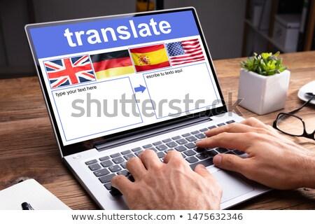 Laptop mutat nyelv alkalmazás nő laptopot használ Stock fotó © AndreyPopov