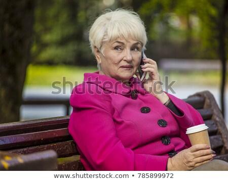 старший женщину питьевой кофе парка старость Сток-фото © dolgachov