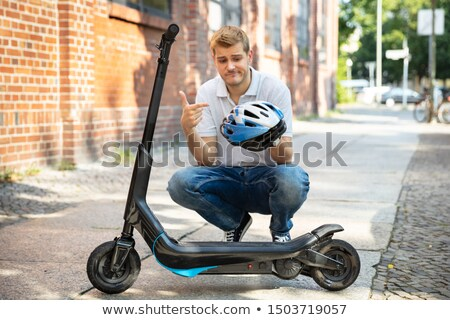 Man Complaining About Helmet For E-Scooter Stock photo © AndreyPopov