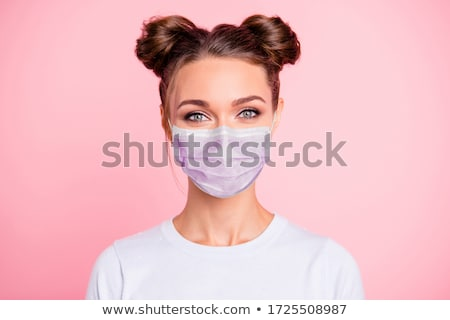beautiful young woman face over pink background Stock photo © dolgachov