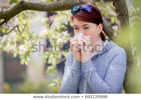 Fiatal nő szenvedés tavasz virágpor allergia nő Stock fotó © Lopolo