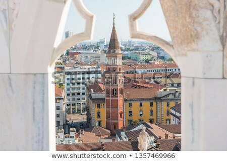 View to tower of San Gottardo from roof of Duomo in Milan Stock photo © vapi