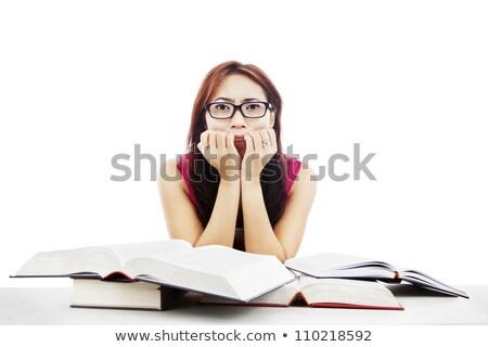 Ijedt tini diák lány szemüveg könyvtár Stock fotó © dolgachov