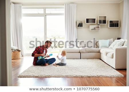 Szczęśliwy ojciec baby syn posiedzenia sofa Zdjęcia stock © dolgachov