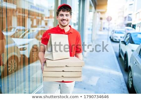 smiling man taking headphones out of parcel box Stock photo © dolgachov