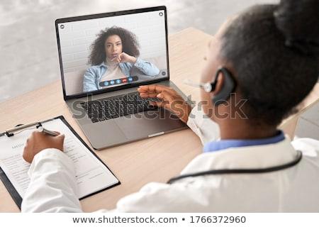 Doktor konuşma hasta çevrimiçi toplantı örnek Stok fotoğraf © artisticco