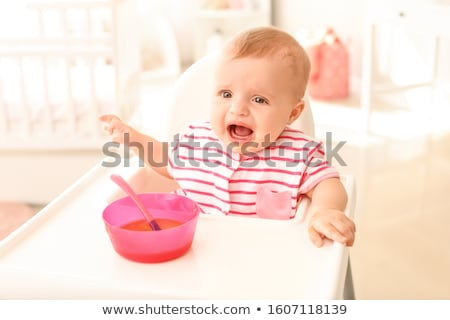 little baby girl crying on a high chair stock photo © kenishirotie