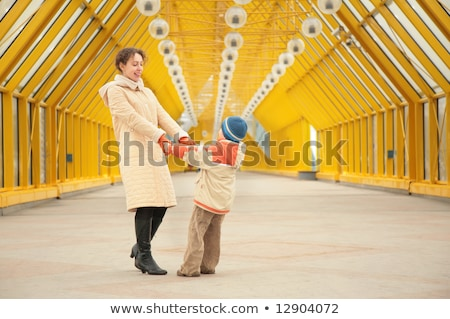 mother and son look each other on footbridge Stock photo © Paha_L
