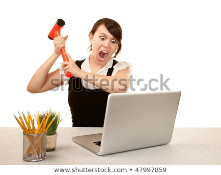 Frustrated office worker smashing keyboard stock photo © nyul