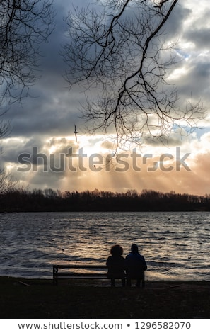 couple sat by lake stock photo © photography33