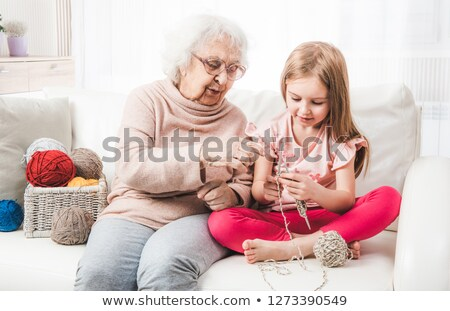 Grandmother teaching a little girl to knit Stock photo © photography33
