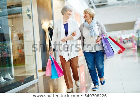 Stock photo: senior woman in a shop