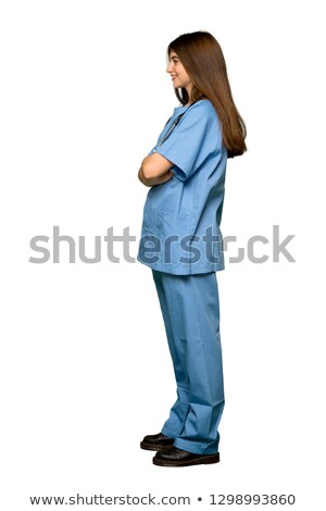 pretty young female nurse side pose stock photo © get4net