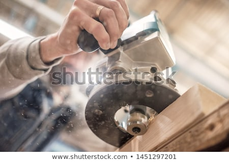 Workman using an electric sander Stock photo © photography33