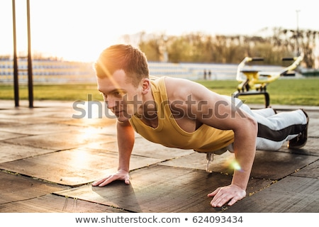 Young people doing press ups in the park Stock photo © photography33