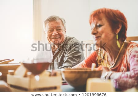 Old couple having meal in restaurant Stock photo © photography33