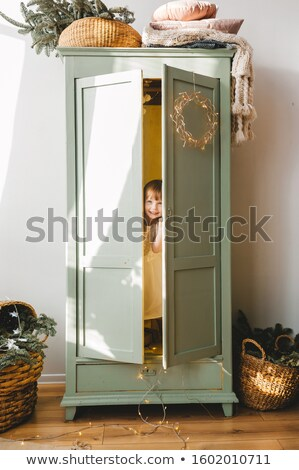Little girl hiding inside the basket Stock photo © pzaxe