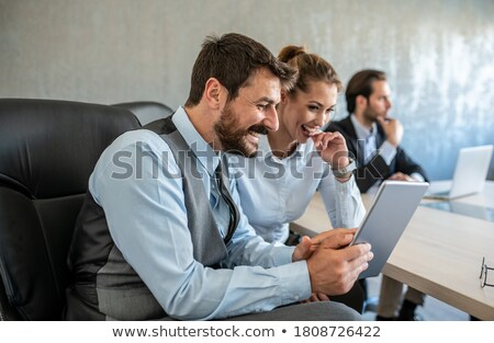 Colleagues commenting statistics Stock photo © photography33