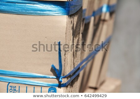 blue background with laptop and cardboard boxes stock photo © wad