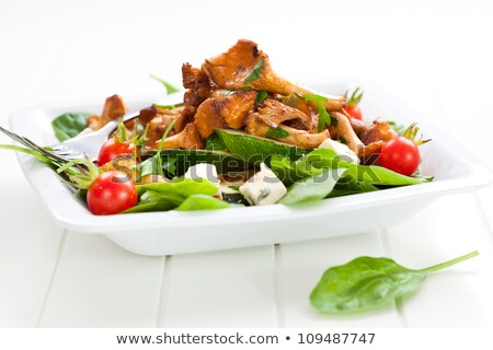 Spinach salad with roasted chanterelle mushrooms Stock photo © brebca