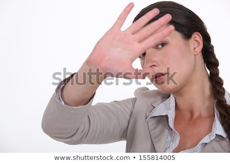 Woman trying to block out the camera Stock photo © photography33