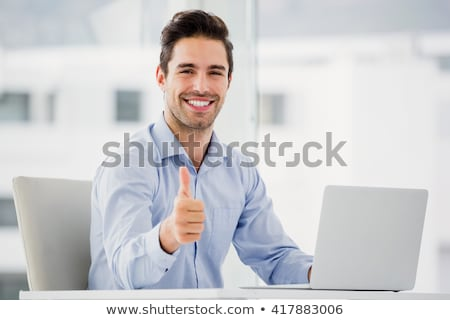 Happy Well-dressed man with thumbs up Stock photo © wavebreak_media