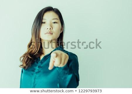 Ciddi genç kadın bakıyor mavi bluz beyaz Stok fotoğraf © pablocalvog