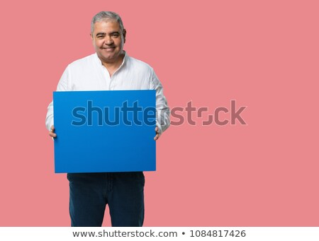 fashion man holds hair and looks at you Stock photo © feedough