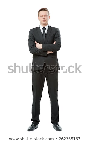 business man stands with legs crossed Stock photo © feedough