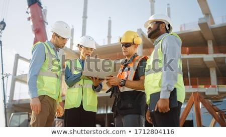 Pracownik budowlany za pomocą laptopa komputera odizolowany biały działalności Zdjęcia stock © Kirill_M