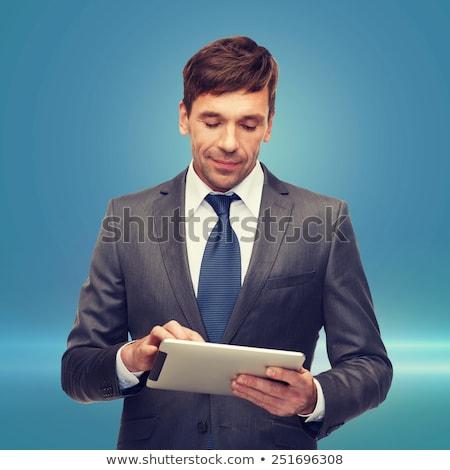 buisnessman with tablet pc stock photo © dolgachov