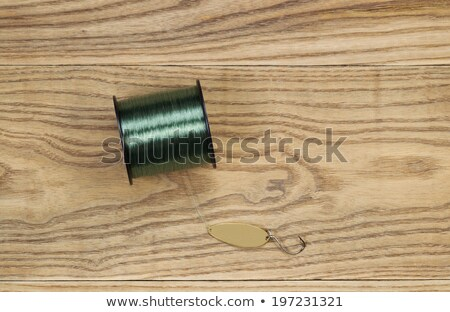 Flat Golden Spoon fishing Lure and Line on Aged Wood  Stock photo © tab62