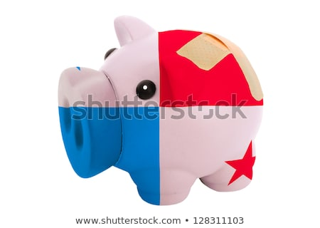closed piggy rich bank with bandage in colors national flag of t stock photo © vepar5