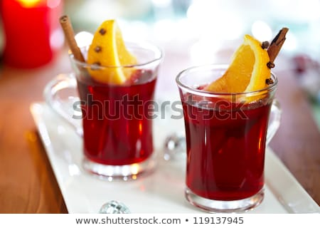 red tea and orange decorated with cloves Stock photo © M-studio