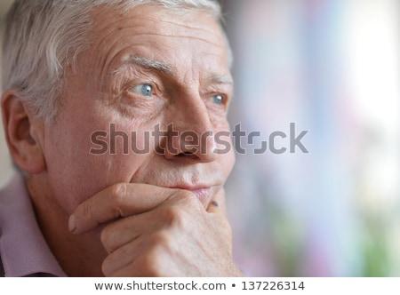 Stock photo: senior man thinkink about something