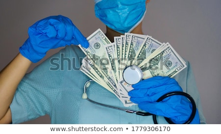 A stethoscope and medicines on dollar bills Stock photo © Zerbor