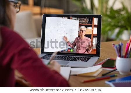 Estudiar curioso nina sesión portátil mirando Foto stock © pressmaster